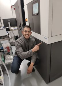 Here is a picture of me with one of our super cool electron microscopes!